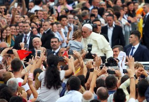 Pope Francis kisses a child during his visit to Albania, in Tirana