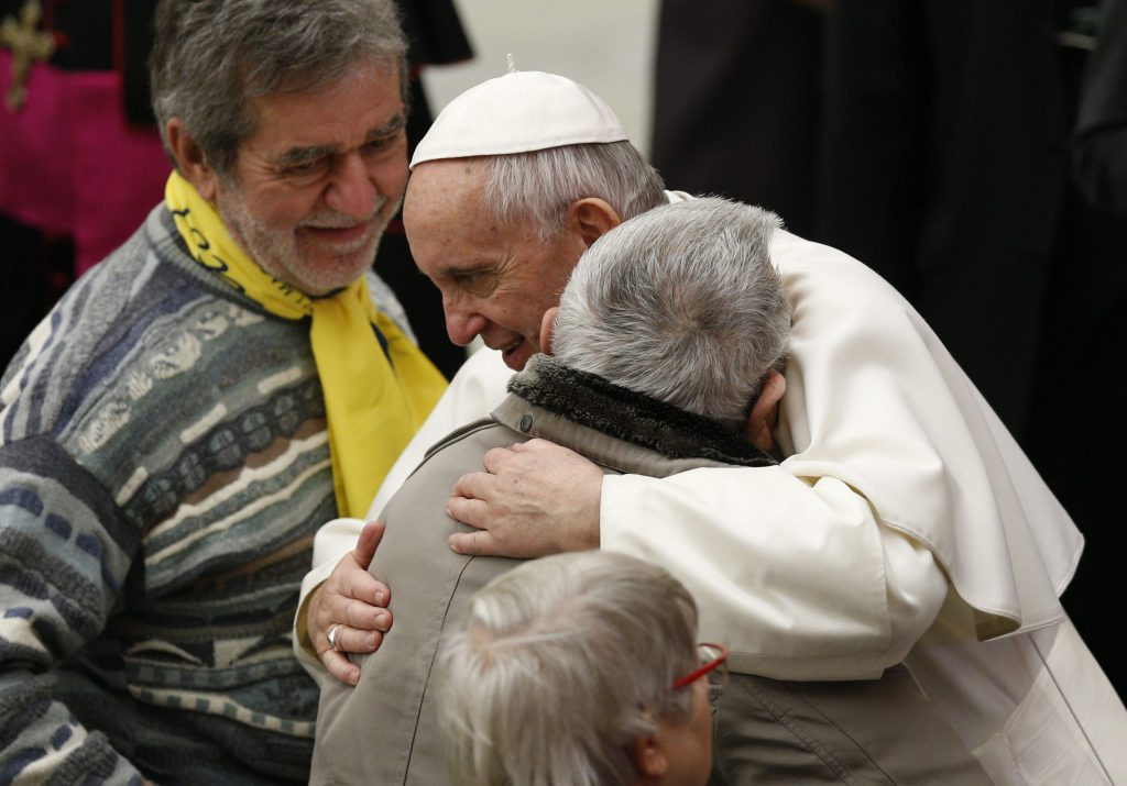 Pope Francis embraces a man while meeting the disabled during his general audience in Paul VI hall at the Vatican Feb. 1. (CNS photo/Paul Haring) See POPE-AUDIENCE-RESURRECTION Feb. 1, 2017.