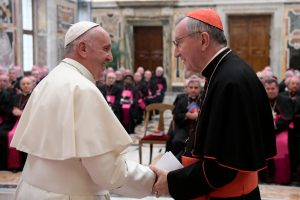 Pope Francis greets Cardinal Pietro Parolin, Vatican secretary of state, during a meeting with nuncios, who represent the pope around the world, in the Apostolic Palace at the Vatican Sept. 17. The pope told the nuncios that the selection of new bishops is his deep concern. Nuncios are instrumental in the selection of new bishops. (CNS photo/L'Osservatore Romano, handout) See POPE-NUNCIOS Sept. 19, 2016.
